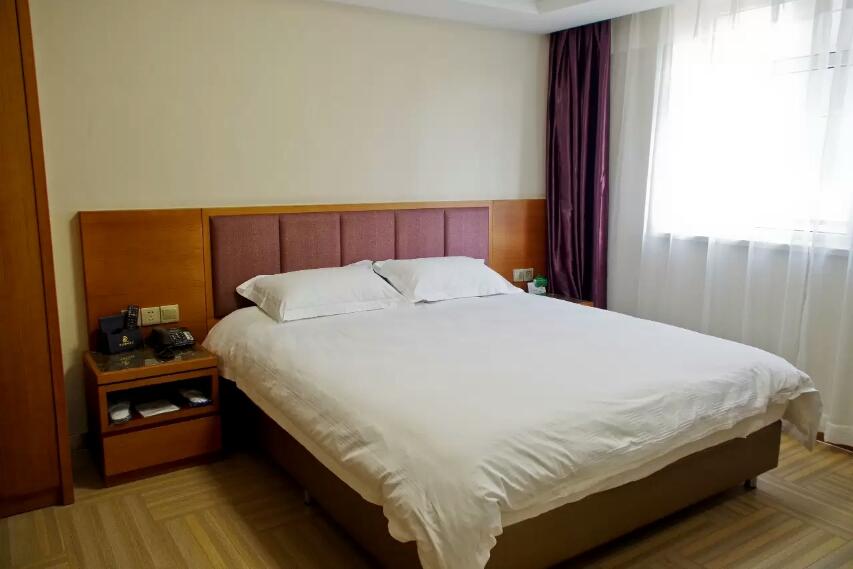 乌鲁木齐孔雀都城酒店(原孔雀大厦)悦居公寓房